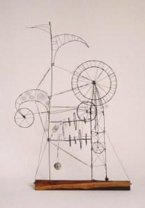 1. The Prayer Maker Machinery - A PRAYER MACHINE -  2011 - James Paterson - 53 x 78 x 25 cm  steel wire , African black wood
